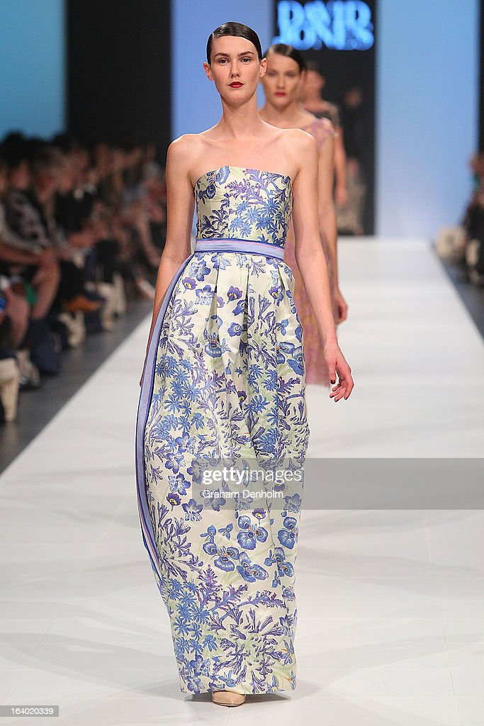 A model showcases designs by Colette Dinnigan during the L'Oreal Melbourne Fashion Festival Opening Event presented by David Jones at Docklands on March 19, 2013 in Melbourne, Australia.