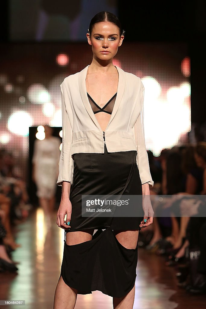 A model showcases designs by Daniella Caputi on the runway during Perth Fashion Festival at The Western Australian Museum on September 13, 2013 in Perth, Australia.