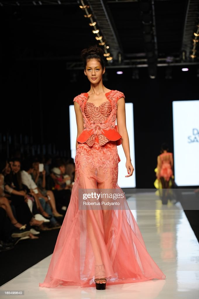 A model showcases designs by Dhanny Satriadi on the runway at the Indonesian Fashion Designer Council show during Jakarta Fashion Week 2014 at Senayan City on October 21, 2013 in Jakarta, Indonesia.