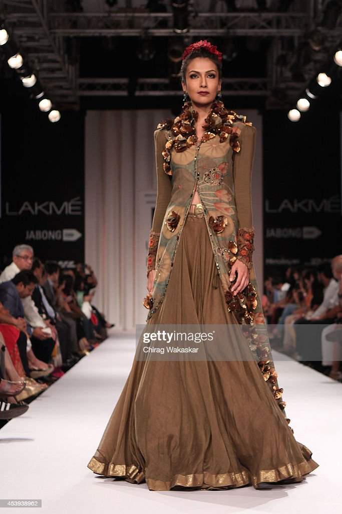 A model showcases designs by Divya Sheth during day 2 of Lakme Fashion Week Winter/Festive 2014 at The Palladium Hotel on August 21, 2014 in Mumbai, India.