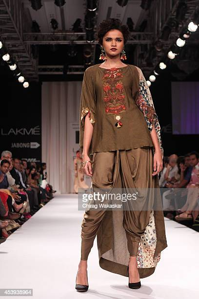 A model showcases designs by Divya Sheth during day 2 of Lakme Fashion Week Winter/Festive 2014 at The Palladium Hotel on August 21 2014 in Mumbai...