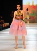 A model showcases designs by Djoko Sasongko on the runway at Tropical Chic show during The 7th Surabaya Fashion Parade 'NIWASANA NUSANTARA 2014' at...