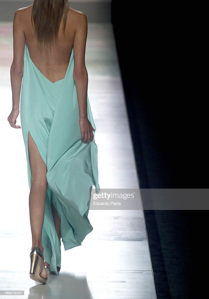 A model showcases designs by Duyos on the runway at Duyos show during Mercedes Benz Fashion Week Madrid Spring/Summer 2014 at Ifema on September 13, 2013 in Madrid, Spain.
