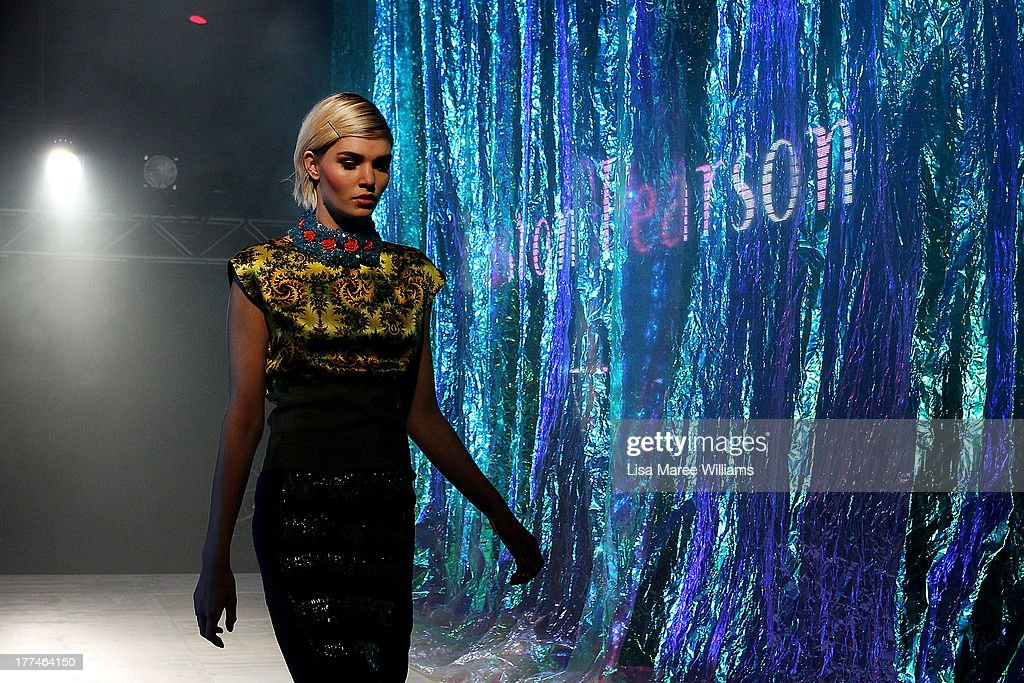 A model showcases designs by Easton Pearson on the runway at the InStyle Red Carpet Runway show during Mercedes-Benz Fashion Festival Sydney 2013 at Sydney Town Hall on August 23, 2013 in Sydney, Australia.