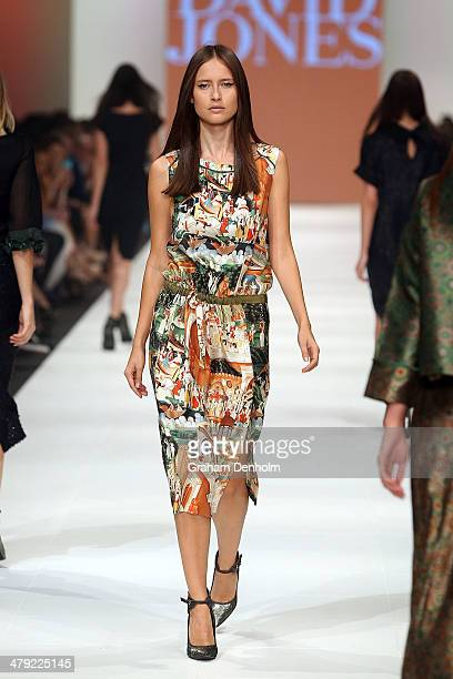 A model showcases designs by Easton Pearson on the runway during the 2014 Virgin Australia Melbourne Fashion Festival Opening Event presented by...