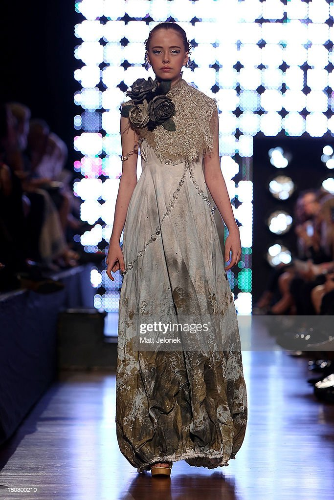 A model showcases designs by Empire Rose on the runway during Perth Fashion Festival at The Western Australian Museum on September 11, 2013 in Perth, Australia.