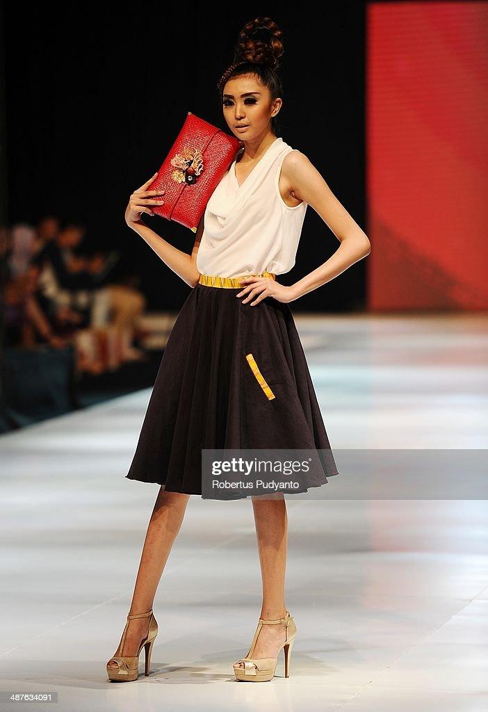A model showcases designs by Estrelita Maya Zefanya on the runway at Mother, I Love You show during The 7th Surabaya Fashion Parade 'NIWASANA NUSANTARA 2014' at Tunjungan Plaza on on May 1, 2014 in Surabaya, Indonesia.