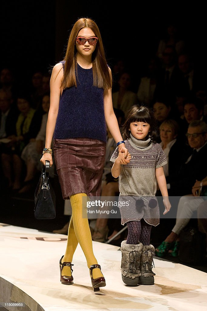 A model showcases designs by Fendi on the runway on Han River island on June 2, 2011 in Seoul, South Korea.