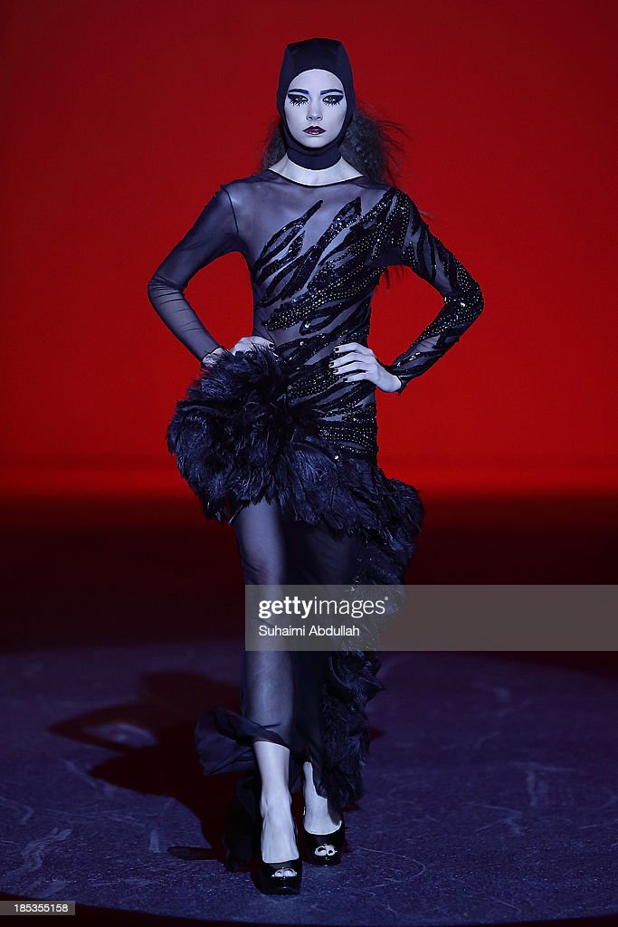 A model showcases designs by Frederick Lee on the catwalk on day 11 of Fashion Week 2013 at the Sands Expo & Convention Centre on October 19, 2013 in Singapore.