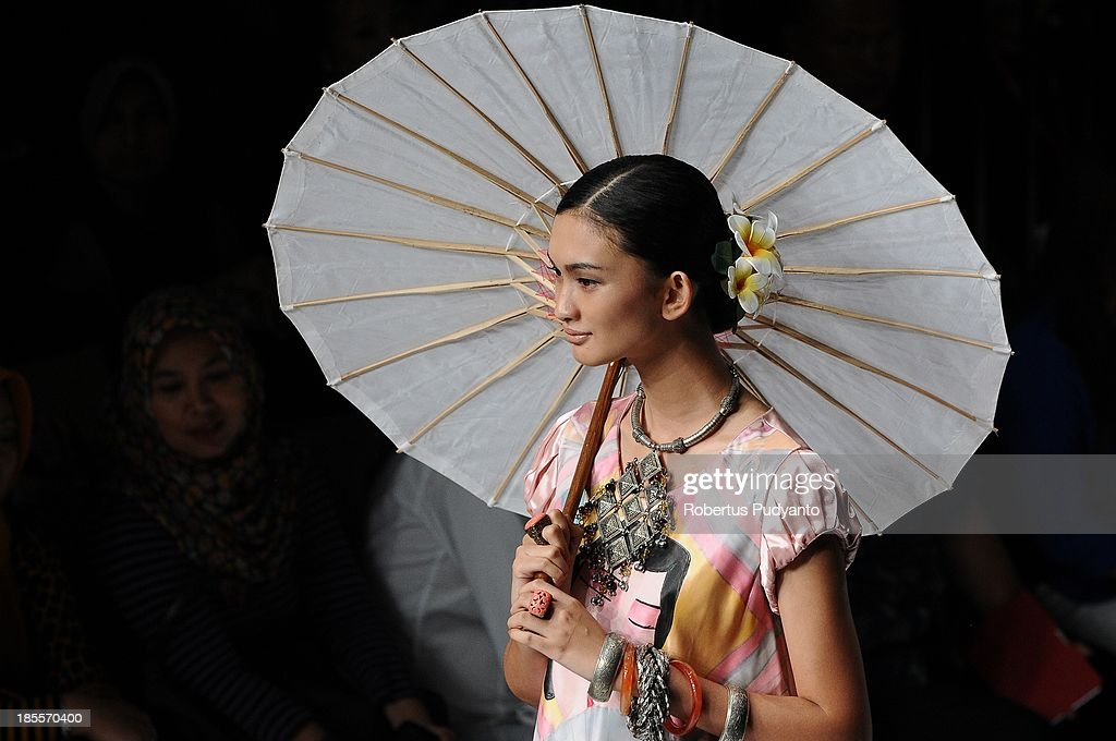 A model showcases designs by Fuji Tjandra on the runway at the Asia Syndrome show during Jakarta Fashion Week 2014 at Senayan City on October 22, 2013 in Jakarta, Indonesia.
