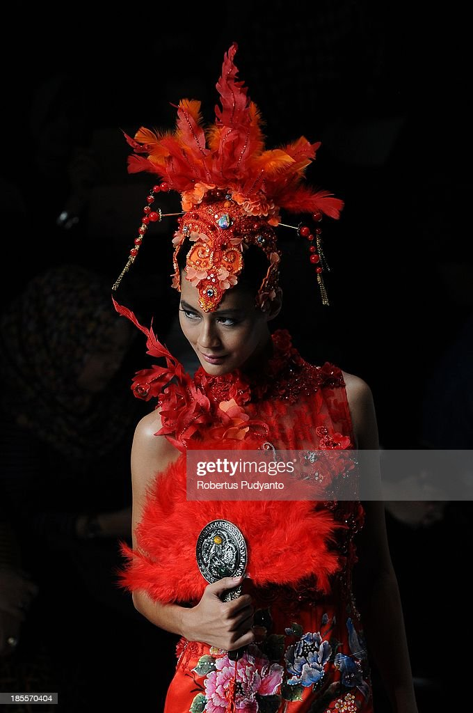 A model showcases designs by Geraldus Sugeng on the runway at the Mythperial show during Jakarta Fashion Week 2014 at Senayan City on October 22, 2013 in Jakarta, Indonesia.