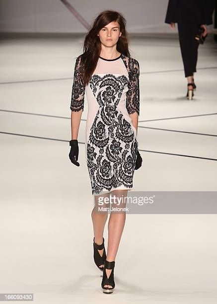 A model showcases designs by Ginger And Smart on the runway at the Ginger And Smart show during MercedesBenz Fashion Week Australia Spring/Summer...