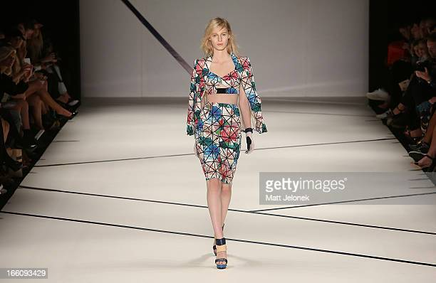 A model showcases designs by Ginger Smart on the runway at the Ginger And Smart show during MercedesBenz Fashion Week Australia Spring/Summer 2013/14...