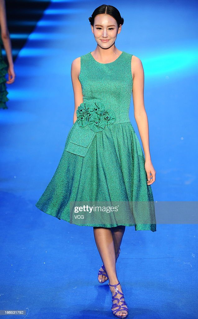 A model showcases designs by Gioia Pan and Mark Cheung on the runway at the 2014 Gioia Pan & Mark Cheung Collection show during Mercedes-Benz China Fashion Week Spring/Summer 2014 at 751 D.PARK Workshop on October 31, 2013 in Beijing, China.
