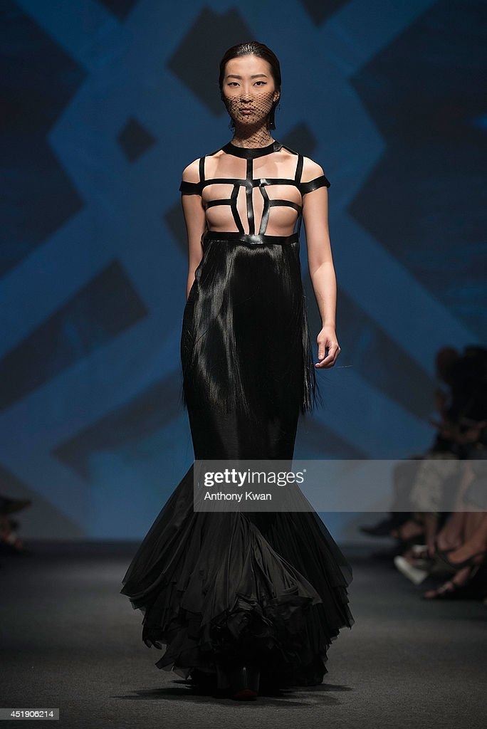 A model showcases designs by Grace CY Lam on the runway during the Raffles Fashion show on day 3 of Hong Kong Fashion Week Spring/Summer 2014 at the Hong Kong Convention and Exhibition Centre on July 9, 2014 in Hong Kong.