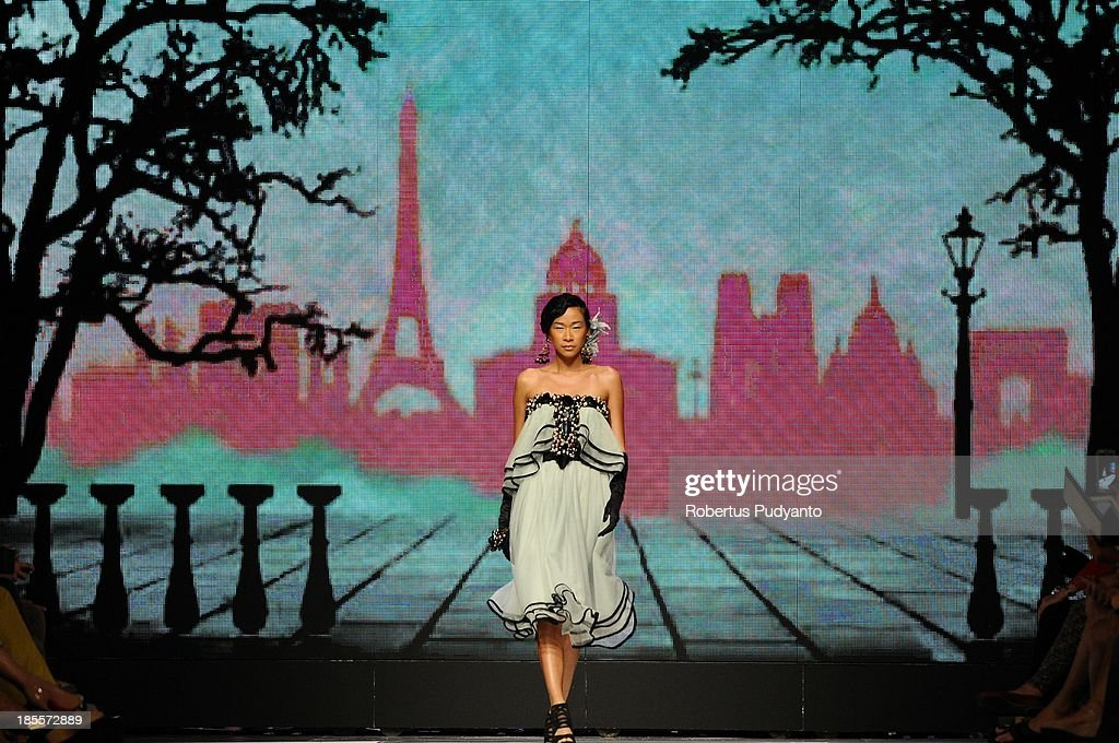 A model showcases designs by Gregorius Vici on the runway at the Spirit of Springs show during Jakarta Fashion Week 2014 at Senayan City on October 22, 2013 in Jakarta, Indonesia.