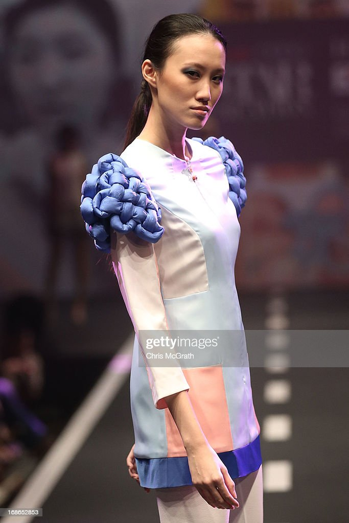 A model showcases designs by Ham Yu Lam of Korea during the Audi Star Creation Runway Showdown event at Tent@Marina Promenade on May 13, 2013 in Singapore.