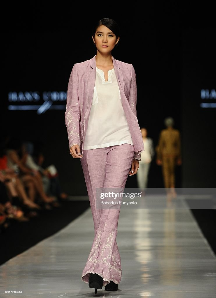 A model showcases designs by Hans Ubbink of Netherlands on the runway at the Erasmus Huis show during Jakarta Fashion Week 2014 at Senayan City on October 24, 2013 in Jakarta, Indonesia.