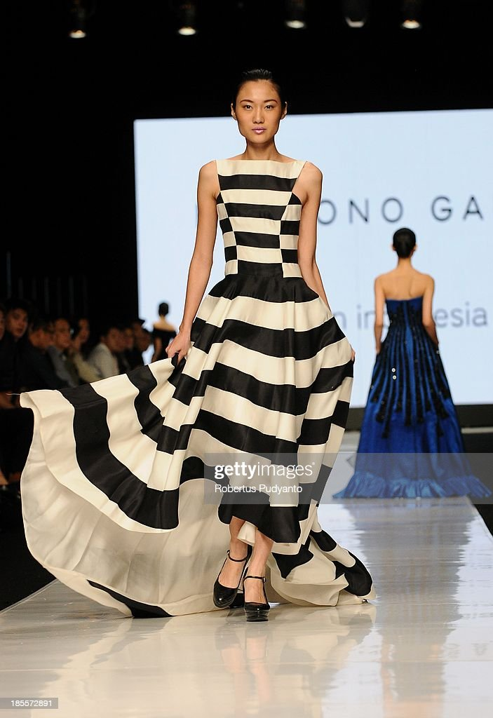 A model showcases designs by Hartono Gan on the runway at the Made in Indonesia show during Jakarta Fashion Week 2014 at Senayan City on October 22, 2013 in Jakarta, Indonesia.