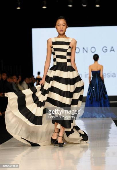 A model showcases designs by Hartono Gan on the runway at the Made in Indonesia show during Jakarta Fashion Week 2014 at Senayan City on October 22...