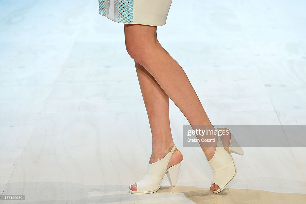 A model showcases designs by Haryono Setiadi on the runway at the MBFWA Trends show during Mercedes-Benz Fashion Festival Sydney 2013 at Sydney Town Hall on August 22, 2013 in Sydney, Australia.