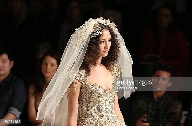 A model showcases designs by Hera Bridal Couture in the New Zealand Weddings Magazine Collection Show at New Zealand Fashion Week 2014 on August 27...