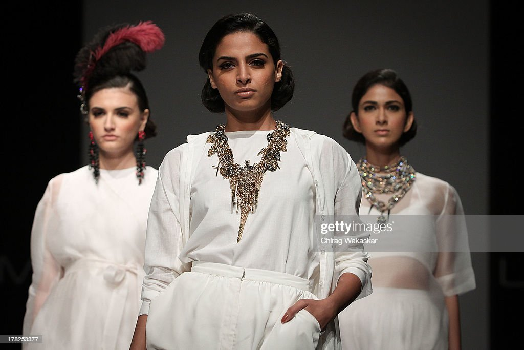 A model showcases designs by House Of Chic by Jinali Sutariya and Heena Surani during day 5 of Lakme Fashion Week Winter/Festive 2013 at the Hotel Grand Hyatt on August 27, 2013 in Mumbai, India.