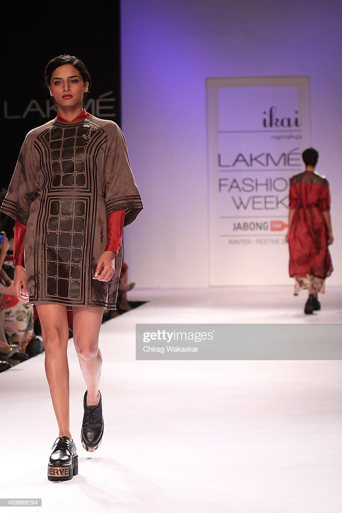 A model showcases designs by IKAI by Ragini Ahuja during day 3 of Lakme Fashion Week Winter/Festive 2014 at The Palladium Hotel on August 22, 2014 in Mumbai, India.