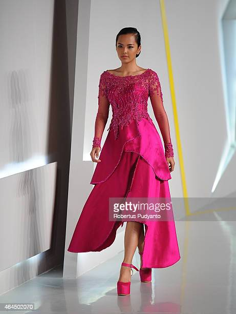 A model showcases designs by Inar on the runway in the Beyond Floral Fantacy show during Indonesia Fashion Week 2015 at Jakarta Convention Center on...