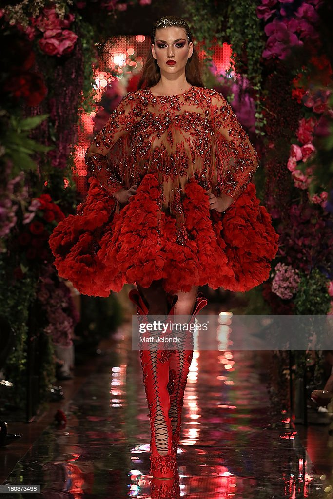 A model showcases designs by Jaime Lee on the runway during Perth Fashion Festival at The Western Australian Museum on September 12, 2013 in Perth, Australia.