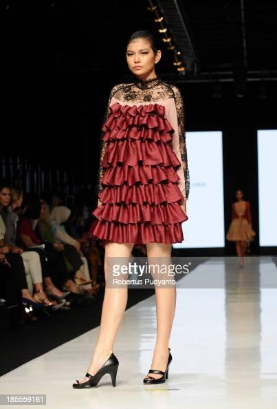 A model showcases designs by Japanese Motonari Ono on the runway during Jakarta Fashion Week 2014 at Senayan City on October 22 2013 in Jakarta...