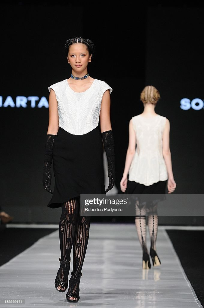 A model showcases designs by Japanese Somarta on the runway during Jakarta Fashion Week 2014 at Senayan City on October 22, 2013 in Jakarta, Indonesia.