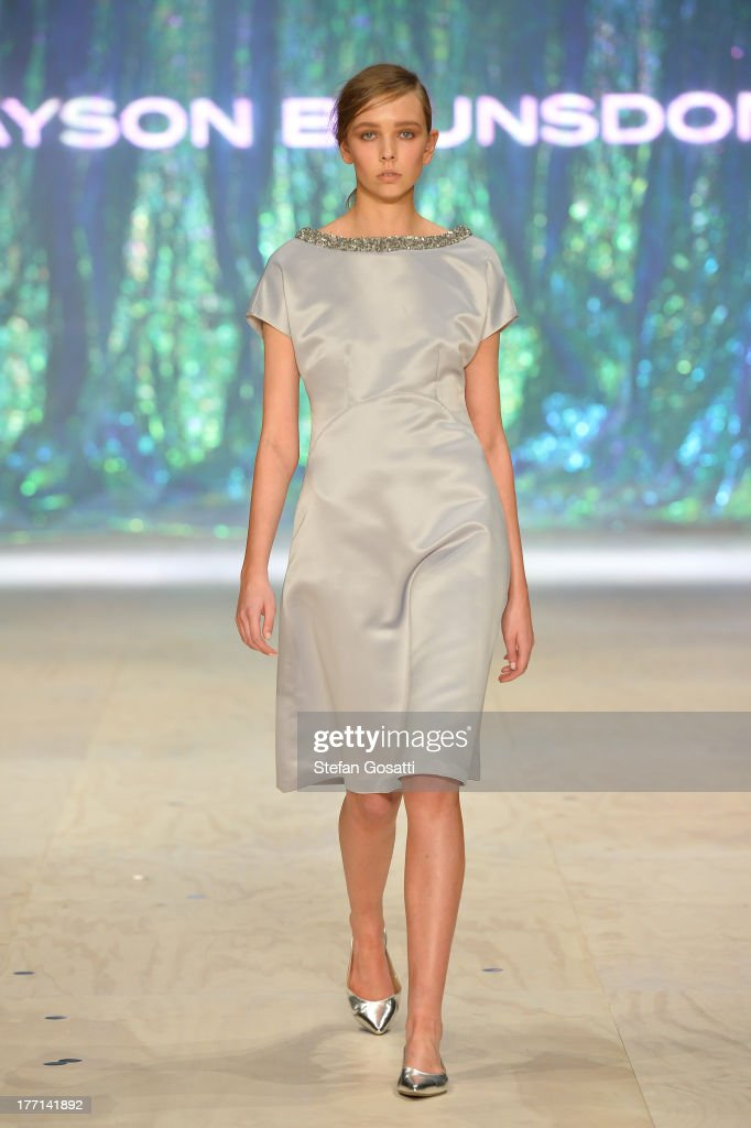 A model showcases designs by Jayson Brunsdon on the runway at the MBFWA Trends show during Mercedes-Benz Fashion Festival Sydney 2013 at Sydney Town Hall on August 21, 2013 in Sydney, Australia.