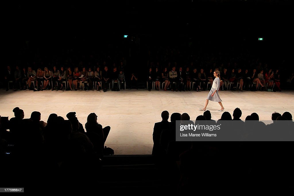 A model showcases designs by Jayson Brunsdon on the runway at the MBFWA Trends show during Mercedes-Benz Fashion Festival Sydney 2013 at Sydney Town Hall on August 24, 2013 in Sydney, Australia.