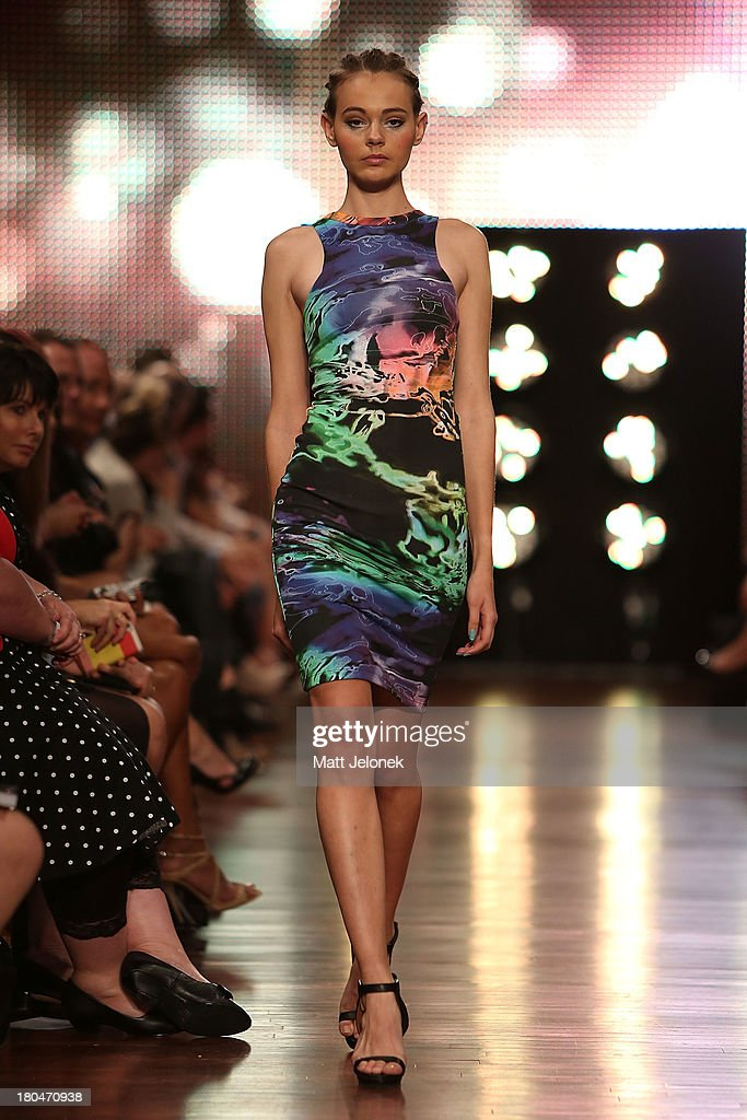 A model showcases designs by Jessica Martino on the runway during Perth Fashion Festival at The Western Australian Museum on September 13, 2013 in Perth, Australia.