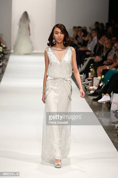 A model showcases designs by John Zimmerman Couture during the New Zealand Weddings Magazine Collection show at New Zealand Fashion Week 2015 on...