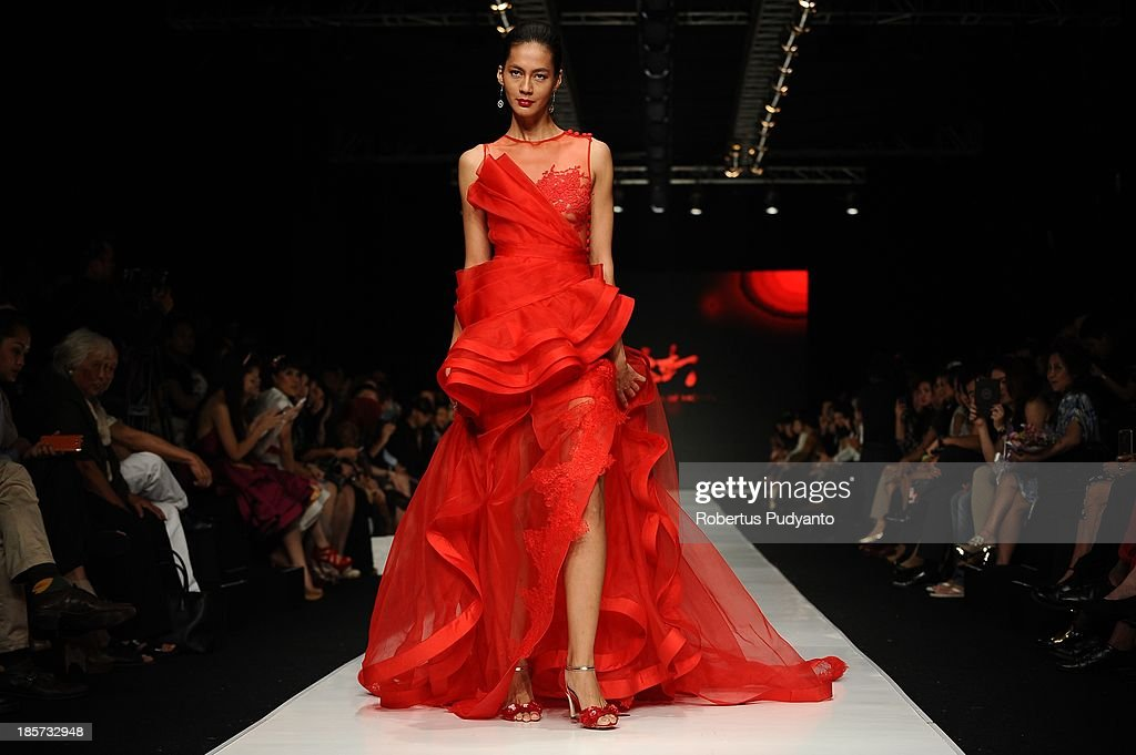 A model showcases designs by Joko Wiyanto on the runway at the Mazda Young Vibrant Designer show during Jakarta Fashion Week 2014 at Senayan City on October 24, 2013 in Jakarta, Indonesia.