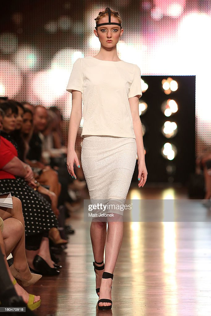 A model showcases designs by Jomay Cao on the runway during Perth Fashion Festival at The Western Australian Museum on September 13, 2013 in Perth, Australia.