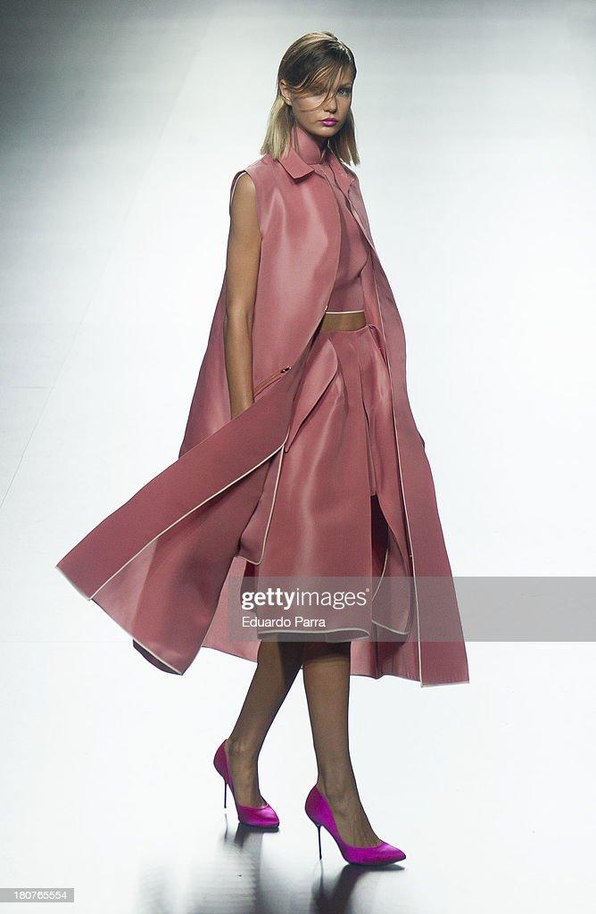 A model showcases designs by Juan Vidal on the runway at Juan Vidal show during Mercedes Benz Fashion Week Madrid Spring/Summer 2014 at Ifema on September 16, 2013 in Madrid, Spain.