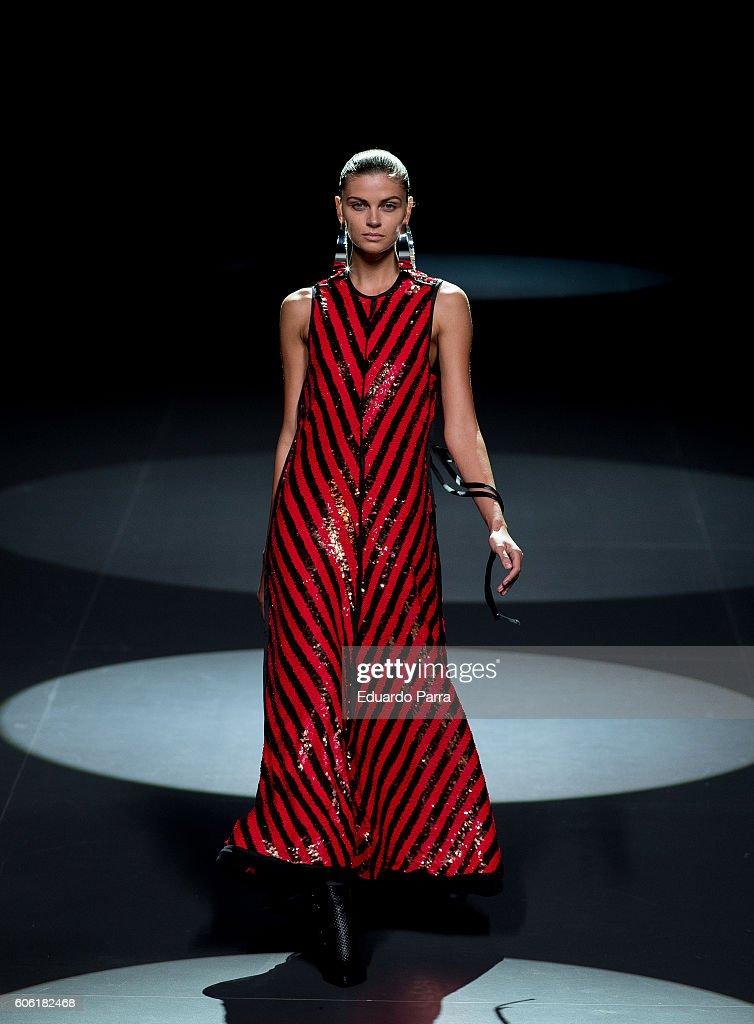 model-showcases-designs-by-juan-vidal-on-the-runway-at-the-juan-vidal-picture-id606182468