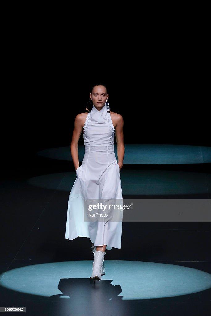 model-showcases-designs-by-juan-vidal-on-the-runway-at-the-juan-vidal-picture-id606509642