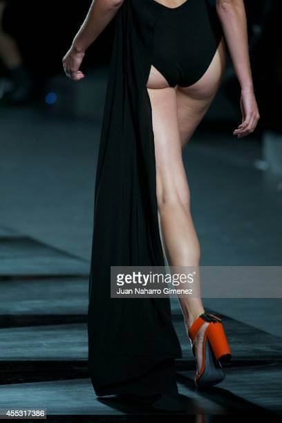 A model showcases designs by Juanjo Oliva on the runway at the Juanjo Oliva show during Mercedes Benz Fashion Week Madrid Spring/Summer 2015 at Ifema...