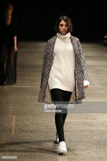 A model showcases designs by Juliette Hogan at New Zealand Fashion Week 2014 on August 27 2014 in Auckland New Zealand