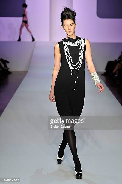 A model showcases designs by Karen Walker on the catwalk during the 'Marie Claire Presents The Gala Opening' catwalk show opening Rosemount Sydney...