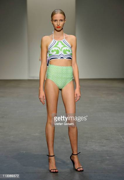 A model showcases designs by Karla Spetic on the catwalk during Rosemount Australian Fashion Week Spring/Summer 2011/12 at Overseas Passenger...