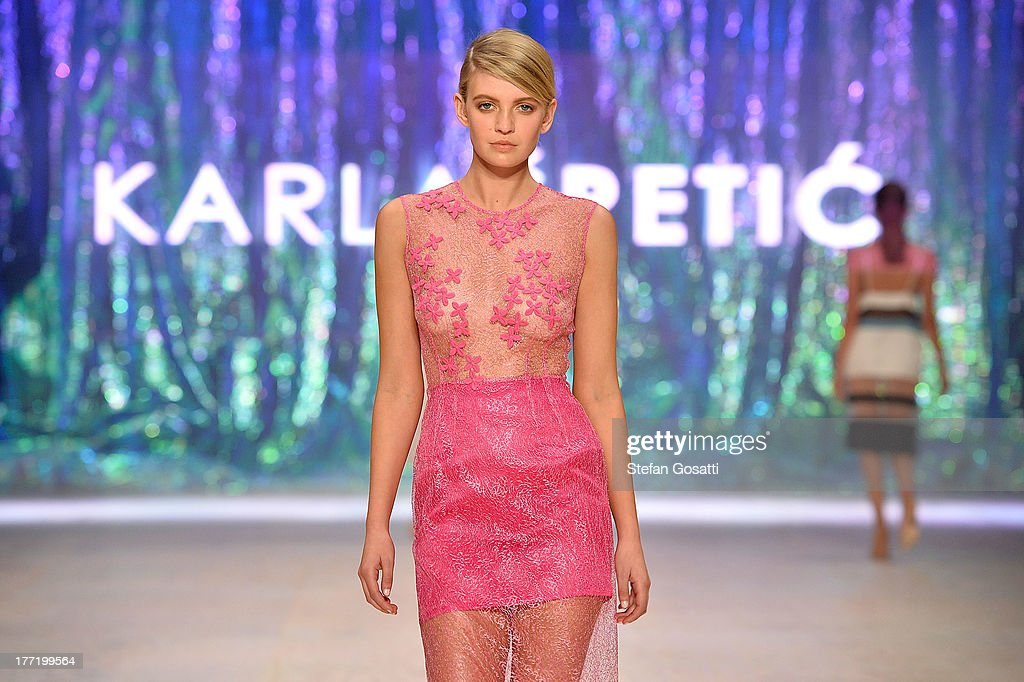 A model showcases designs by Karla Spetic on the runway at the MBFWA Trends show during Mercedes-Benz Fashion Festival Sydney 2013 at Sydney Town Hall on August 22, 2013 in Sydney, Australia.