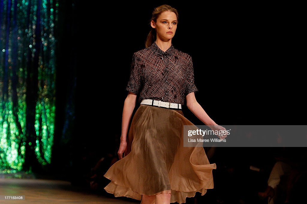 A model showcases designs by Kate Sylvester on the runway at the MBFWA Trends show during Mercedes-Benz Fashion Festival Sydney 2013 at Sydney Town Hall on August 21, 2013 in Sydney, Australia.