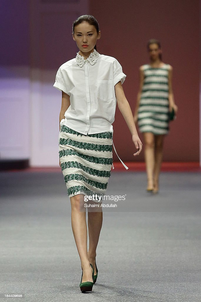 A model showcases designs by Keita Maruyama on the catwalk on day 5 of Fashion Week 2013 at the Sands Expo & Convention Centre on October 13, 2013 in Singapore.
