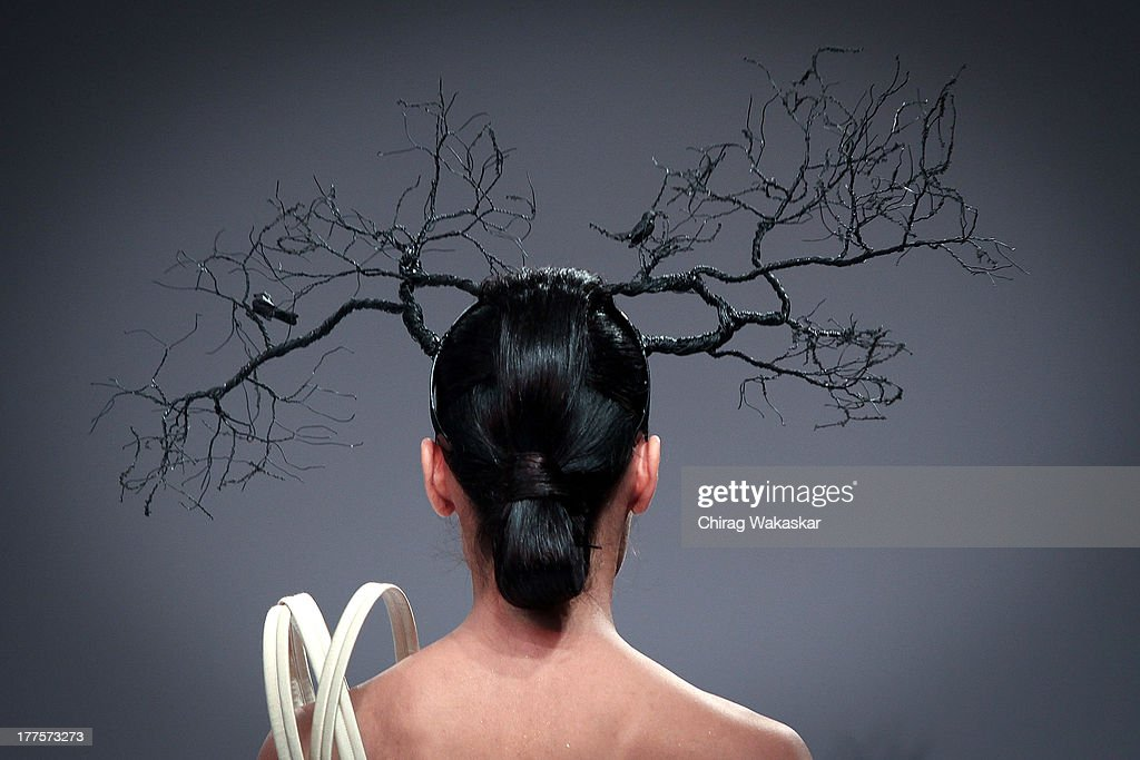 A model showcases designs by Ken Ferns on the runway during day 2 of Lakme Fashion Week Winter/Festive 2013 at the Hotel Grand Hyatt on August 24, 2013 in Mumbai, India.