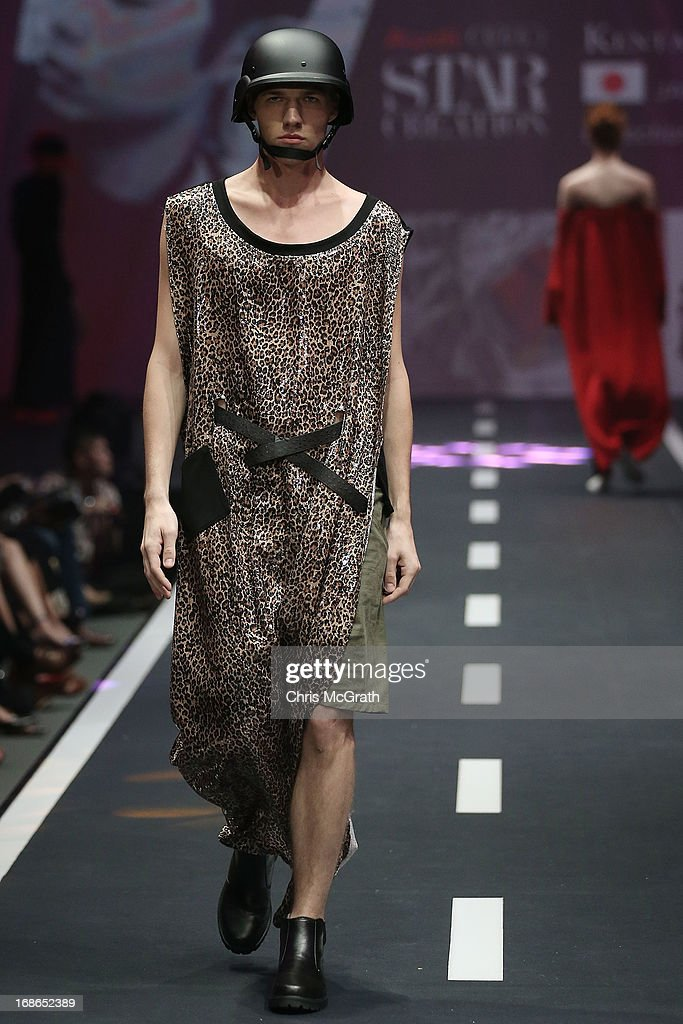 A model showcases designs by Kentaro Fujiki of Japan during the Audi Star Creation Runway Showdown event at Tent@Marina Promenade on May 13, 2013 in Singapore.